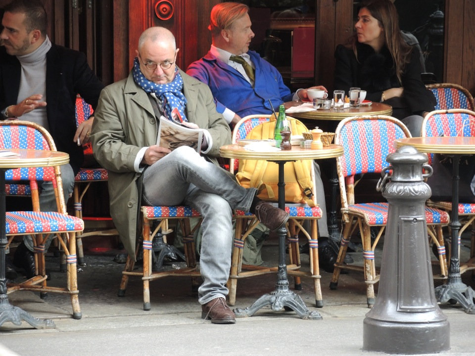 man in scarf at cafe